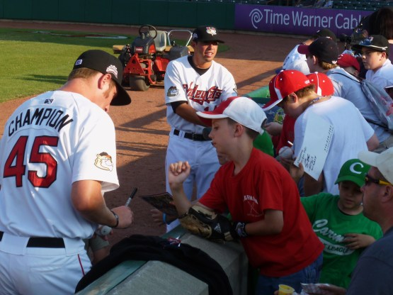 Adam Champion and Travis Blankenship sign autographs