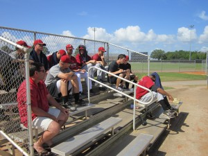 Some pitchers not throwing, watch the game from the stands to chart pitches.