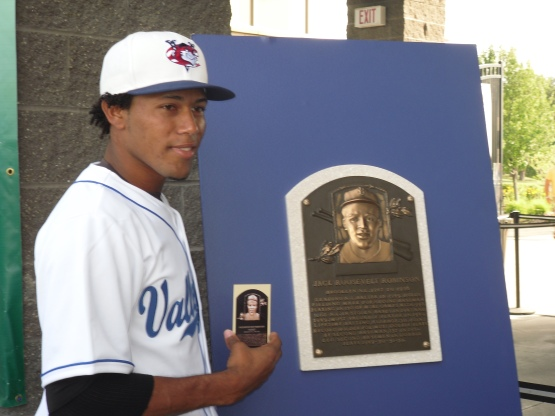 Jorge De Leon poses with the original Jackie Robinon Hall of Fame plaque.