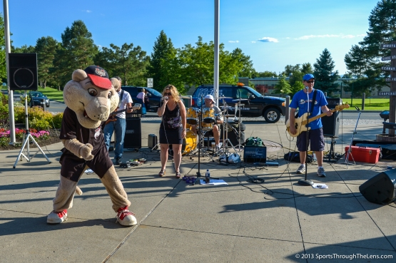 Southpaw rocks out with our 80's Tribute band before the game