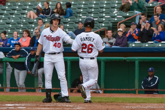 Jon Kemmer greets James Ramsay after he scores in the 2nd inning on the 'Cats 9-6 win