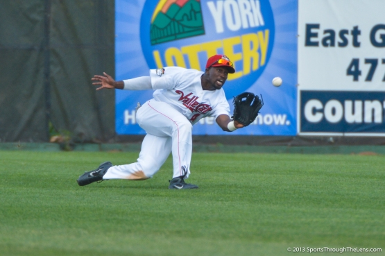 'Cats OF D'Andre Toney makes a diving grab in the 1st game of the doubleheader against Connecticut