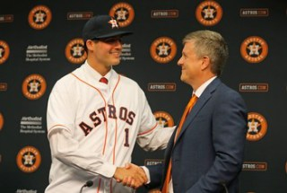 Appel shaking hands with Astros GM Jeff Luhnow at the righty's introductory press conference on June 19th