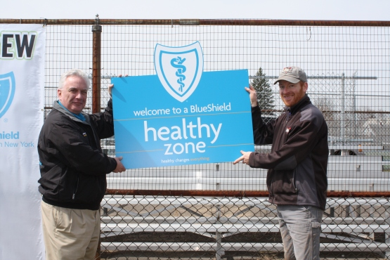 Dr. Kirk Panneton, Regional Executive and Medical Director, BlueShield of Northeastern New York (L), and Matt Callahan, Assistant General Manager, Tri-City ValleyCats.