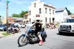 SOUTHPAW ON MOTORCYCLE POINTING 2