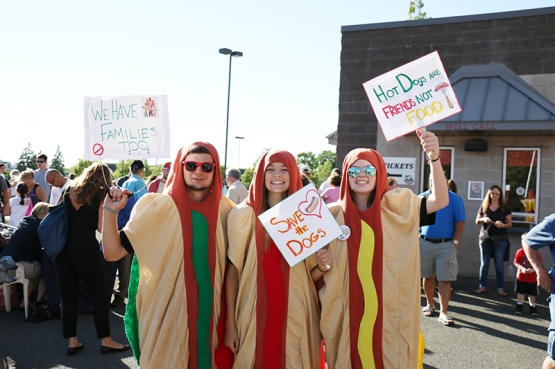 A group of hot dogs protesting 50 cent hot dog night!