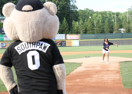 Kristal Coloney, Territory Manager for Combined Insurance, threw a strike on her Fourth of July ceremonial first pitch!