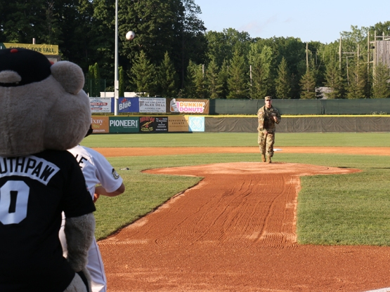 The U.S. Army representative throwing out a ceremonial first pitch.