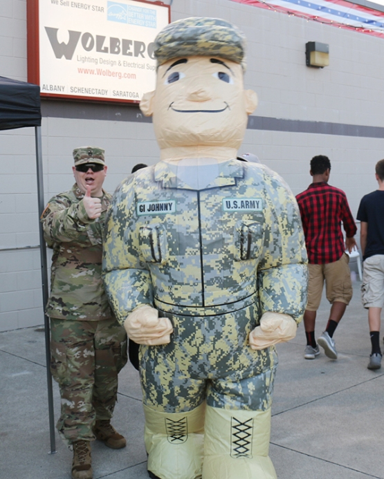 "The U.S. Army had an inflatable mascot walking around ""The Joe"" during the game, visiting with fans!"