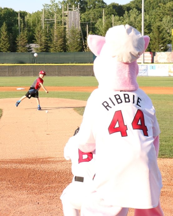 Raffle winner Brennan Thomas threw out a ceremonial first pitch to Charlie with Ribbie serving as the umpire.