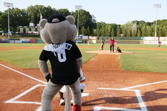Dr. White brought her four-legged friend CC to the mound to help throw out the ceremonial first pitch.