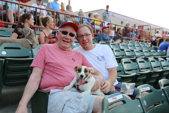 A pair of 'Cats fans with their furry friend!