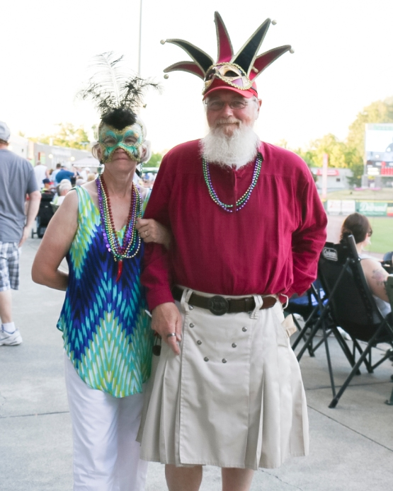 A pair of the many fans dressed in Mardi Gras attire!