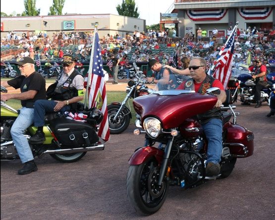 The Patriot Guard Riders cruised around the warning track for a pregame parade before stopping around the plate and in front of both dugouts as part of the national anthem festivities.