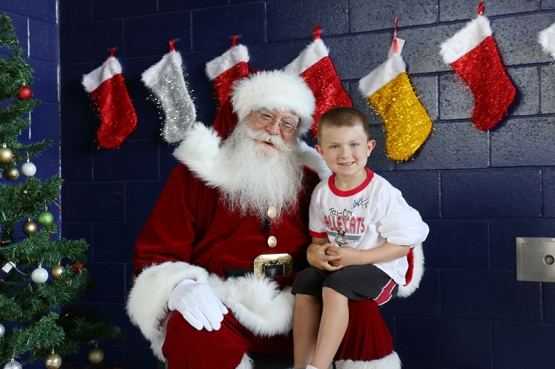 Santa Claus with one of the ValleyCats younger fans.