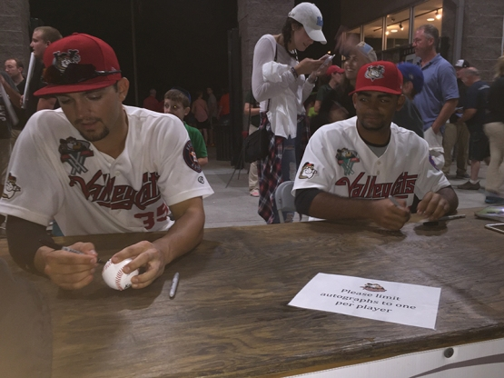 Spencer Johnson and Edgardo Sandoval signed for fans at the Mohawk Honda Autograph Table.